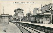 La gare d'Épinay-sur-Seine sur la Ligne des Grésillons (actuel RER C). Sur le second pont passe la Grande Ceinture