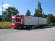 Truck with trailer owned and operated by Europa flyer in Helsingborg, Sweden. Photo in July 2005 in Stockholm
