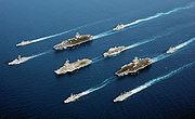 Image de bâtiments de 5 nations engagées dans l'opération Enduring Freedom en mer d'Oman. En 4 colonnes, de en haut à gauche à en bas à droite: ITS Maestrale (F 570), FS De Grasse (D 612), USS John C. Stennis (CVN 74), USS Port Royal (CG 73), FS Charles de Gaulle (R 91), HMS Ocean (L 12), FS Surcouf (F 711), USS John F. Kennedy (CV 67), HNLMS Van Amstel (F 831), et ITS Luigi Durand de la Penne (D 560) (18 avril 2002)