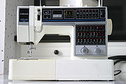 Machine à coudre domestique moderne