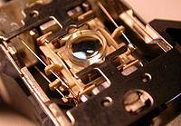 La lentille d'un lecteur de disque compact.