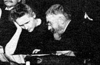 Marie Curie et Henri Poincaré au premier Congrès Solvay en 1911.