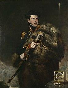 Portrait avec, à côté de lui, une boussole d'inclinaison qu'il utilisa pour rechercher le pôle Sud magnétique.