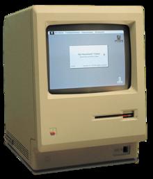 Un ordinateur beige en forme de pavé vertical, affichant quelques icônes.