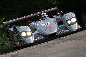 Allan McNish en 2006 dans une épreuve d'ALMS sur l'Audi R8, la voiture de sport-prototype la plus emblématique des années 2000.