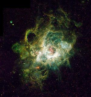 NGC 604, une nébuleuse à émission, pouponnière d'étoiles, dans la constellation du Triangle. Photo prise par Hubble en 1995.