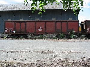 Wagon tombereau à bogies, transport de ballast