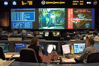 Salle de contrôle durant STS 115.